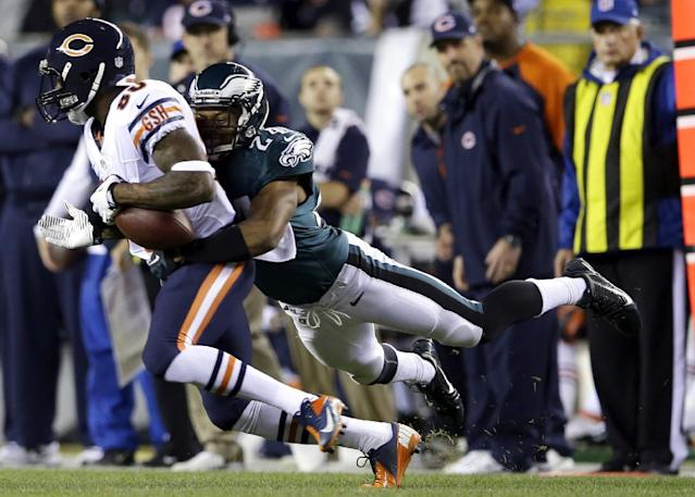 Chicago Bears' Earl Bennett, left, is tackled by Philadelphia Eagles' Bradley Fletcher during the first half of an NFL football game, Sunday, Dec. 22, 2013, in Philadelphia. (AP Photo/Michael Perez)