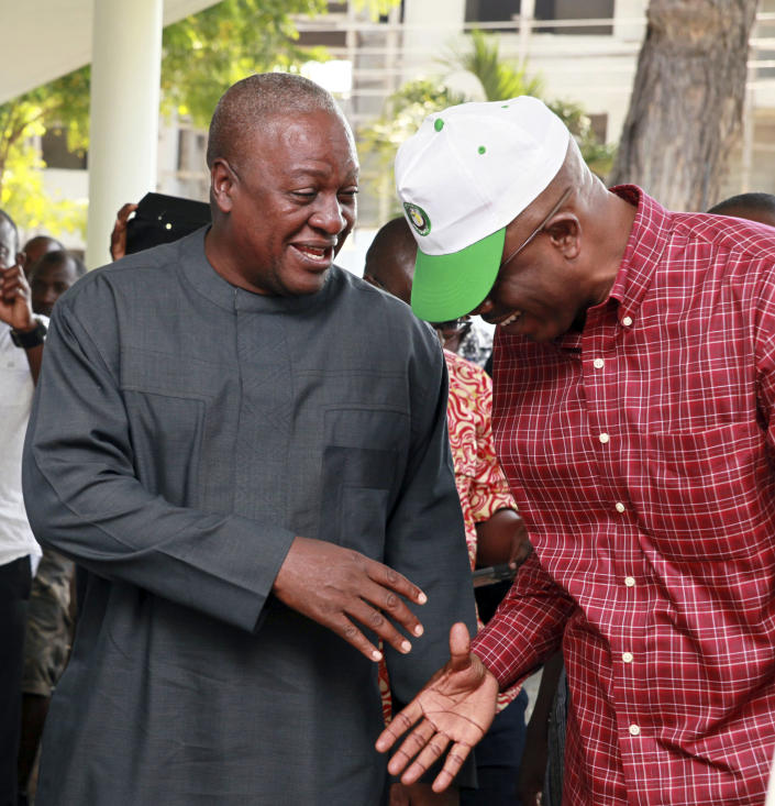 Ghana President John Dramani Mahama, left, speaks with an unidentified representative of regional body ECOWAS, as he talks with election observers and ruling party members following a press conference at the presidential residence in Accra, Ghana, Sunday, Dec. 9, 2012. As voting continued for an unplanned second day on Saturday, international observers endorsed Ghana's presidential and parliamentary polls, despite the delays at some polling stations that led to the extended vote. Polls show that a very tight race with voters almost evenly split between President Mahama and his main challenger, Nana Akufo-Addo. (AP Photo/Christian Thompson)