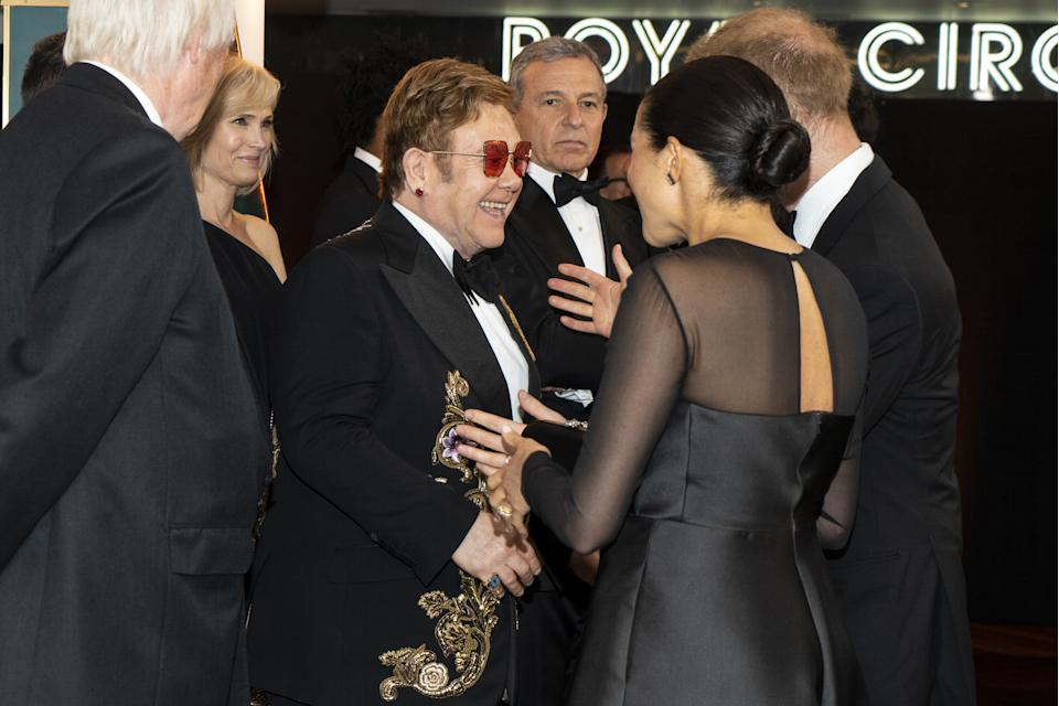 TOPSHOT - Britain's Prince Harry, Duke of Sussex (R) and Britain's Meghan, Duchess of Sussex (2nd R) chat with British singer-songwriter Elton John (C) as they arrive to attend the European premiere of the film The Lion King in London on July 14, 2019. (Photo by Niklas HALLE'N / POOL / AFP)        (Photo credit should read NIKLAS HALLE'N/AFP/Getty Images)