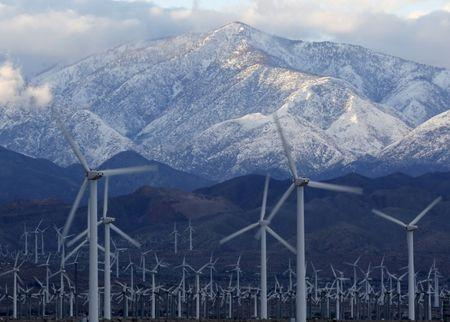 Snow is seen on the San Gorgonio Mountains behind a windmill farm in Palm Springs, California, January 7, 2016. REUTERS/Sam Mircovich