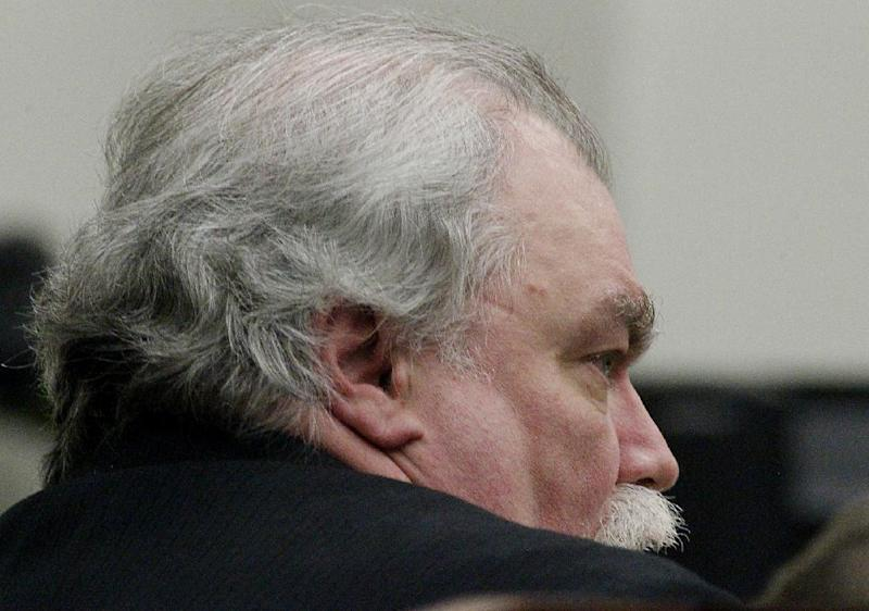 Defendant Richard J. Beasley listens to the closing statements and jury instructions during his trial in Summit County Judge Lynne S. Callahan's court on Monday, March 11, 2013 in Akron, Ohio. The murder case against Beasley, the alleged triggerman charged with killing three men by luring them with Craigslist job offers went to the jury on Monday after the prosecution asked jurors to use common sense and return a guilty verdict. (AP Photo/Akron Beacon Journal, Paul Tople, Pool)