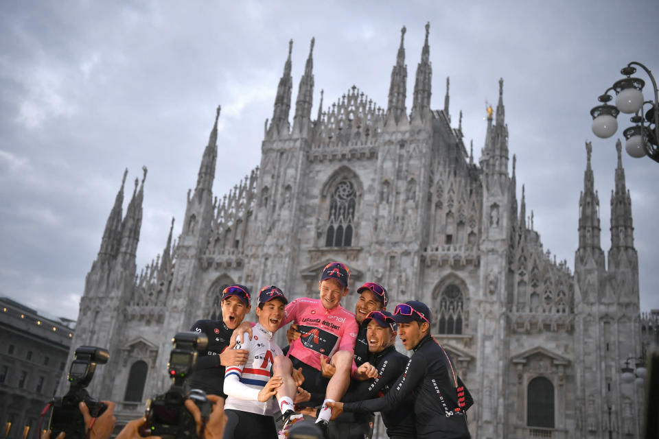 Britain's Tao Geoghegan Hart is backdropped by the gothic cathedral as he celebrates with teammates after winning the Giro d'Italia cycling race, in Milan, Italy, Sunday, Oct. 25, 2020. In one of the most exciting final stages of a Grand Tour, British rider Tao Geoghegan Hart won the Giro d'Italia on Sunday, edging out Australian Jai Hindley by just 39 seconds. (Marco Alpozzi/LaPresse via AP)