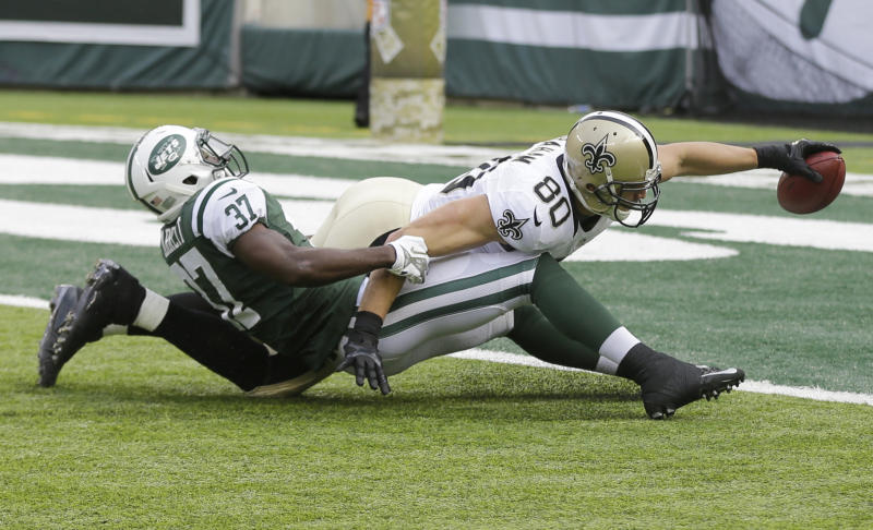 New Orleans Saints tight end Jimmy Graham (80) dives forward for a touchdown as New York Jets free safety Jaiquawn Jarrett (37) attempts to stop him during the first half of an NFL football game Sunday, Nov. 3, 2013, in East Rutherford, N.J. (AP Photo/Mel Evans)