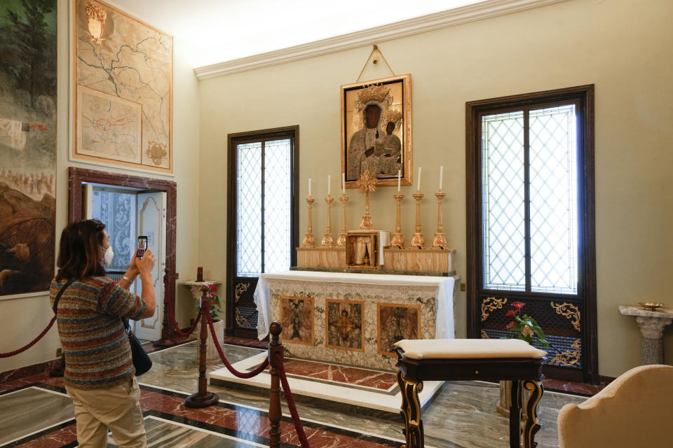 A visitor takes photos of the popes' private chapel, where Pope Francis went to pray with Pope Benedict XVI just after being elected in 2013, inside the Papal Palace in Castel Gandolfo, some 30 kilometers southeast of Rome, Saturday, May 29, 2021. As Covid-19 restrictions are slowly being lifted in Italy, thousands of people are returning to visit the extensive gardens and apartments at the Papal Palace of Castel Gandolfo in the Alban Hills near Rome, that for hundreds of years have been the summer retreat for Popes seeking to escape the suffocating heat of Rome. (AP Photo/Andrew Medichini)