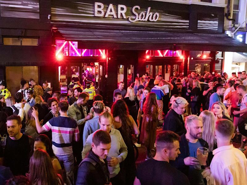 Revellers drink and socialise in the street in Soho, London, 4 July 2020: Vickie Flores/EPA