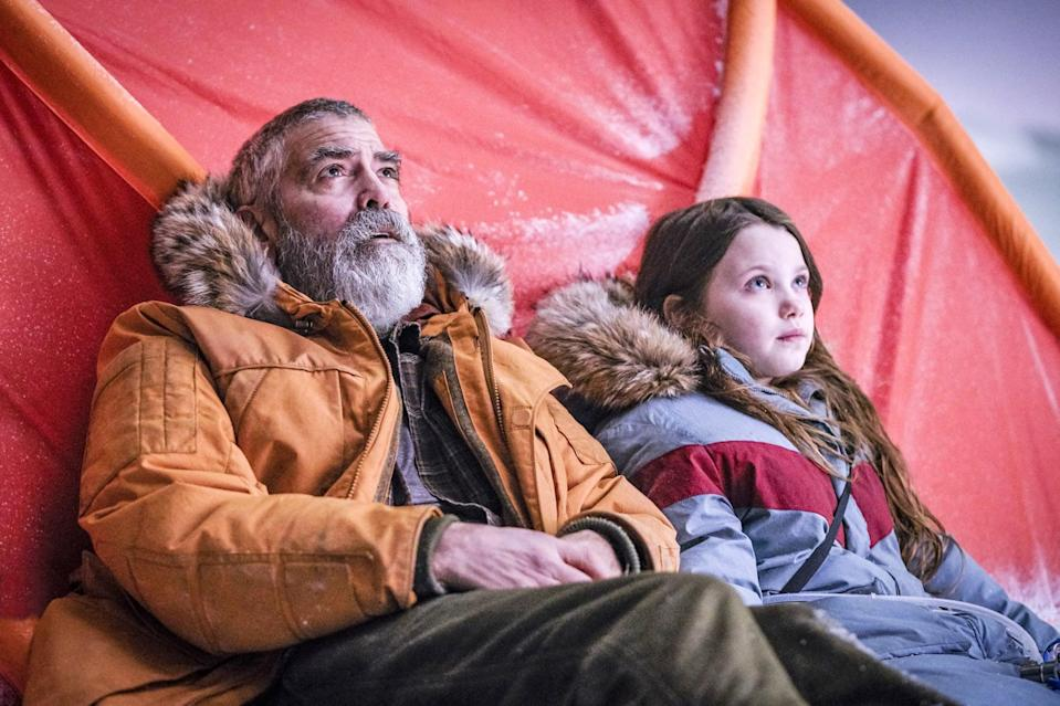 """<p><strong>The Midnight Sky</strong> is another gut punch of an apocalypse movie highlighting the bonds between fathers and daughters. It also happens to star a rugged <a class=""""link rapid-noclick-resp"""" href=""""https://www.popsugar.co.uk/George-Clooney"""" rel=""""nofollow noopener"""" target=""""_blank"""" data-ylk=""""slk:George Clooney"""">George Clooney</a> as a scientist living alone in the Arctic who is desperately trying to warn a group of astronauts not to return to Earth. </p> <p><a href=""""https://www.netflix.com/watch/80244645"""" class=""""link rapid-noclick-resp"""" rel=""""nofollow noopener"""" target=""""_blank"""" data-ylk=""""slk:Watch The Midnight Sky on Netflix."""">Watch <strong>The Midnight Sky</strong> on Netflix.</a></p>"""