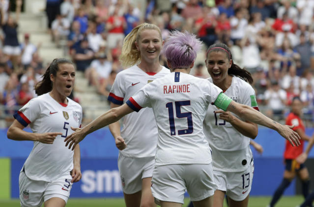 United States' Megan Rapinoe, front, celebrates with teammates after scoring the opening goal from a penalty kick during the Women's World Cup round of 16 soccer match between Spain and US at the Stade Auguste-Delaune in Reims, France, Monday, June 24, 2019. (AP Photo/Alessandra Tarantino)