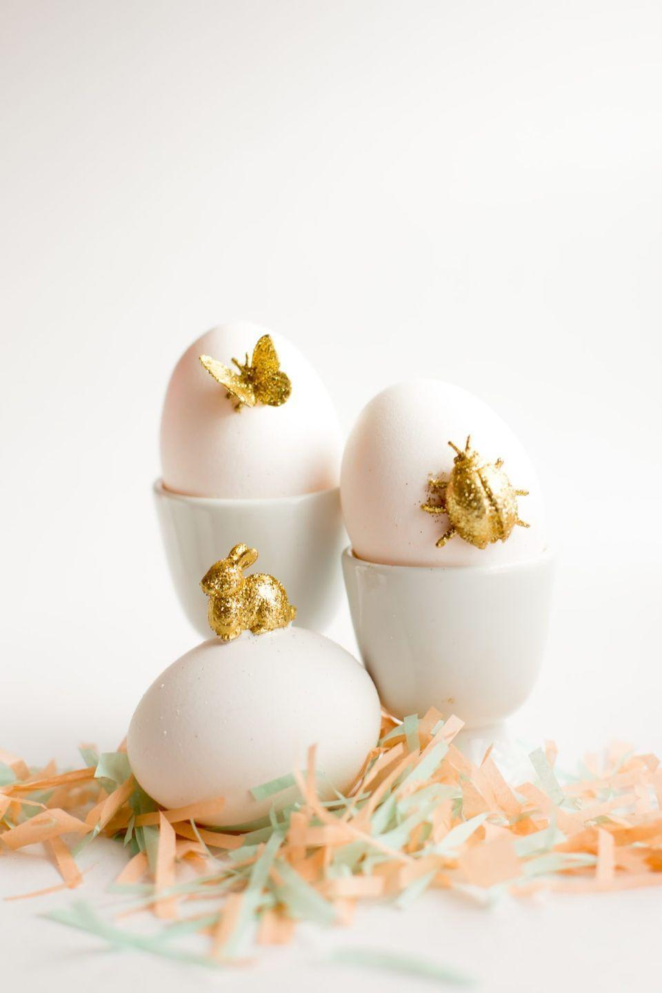"<p>Grab a pack of your kids' favorite mini animals and convert them into perfectly proportioned Easter egg adornments, thanks to a bit of gold paint and glitter. </p><p><strong>Get the tutorial at <a href=""https://www.flaxandtwine.com/2015/03/gold-animal-easter-eggs-diy/"" rel=""nofollow noopener"" target=""_blank"" data-ylk=""slk:Flax & Twine"" class=""link rapid-noclick-resp"">Flax & Twine</a>.</strong></p><p><a class=""link rapid-noclick-resp"" href=""https://www.amazon.com/Pack-Fake-Bugs-Realistic-Insects/dp/B07RF5DK1J/ref=sr_1_1_sspa?tag=syn-yahoo-20&ascsubtag=%5Bartid%7C10050.g.1282%5Bsrc%7Cyahoo-us"" rel=""nofollow noopener"" target=""_blank"" data-ylk=""slk:SHOP PLASTIC ANIMALS"">SHOP PLASTIC ANIMALS</a></p>"