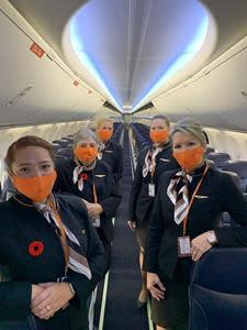 Sunwing flight crew on board Sunwing Airline's first returning flight to Punta Cana since March.
