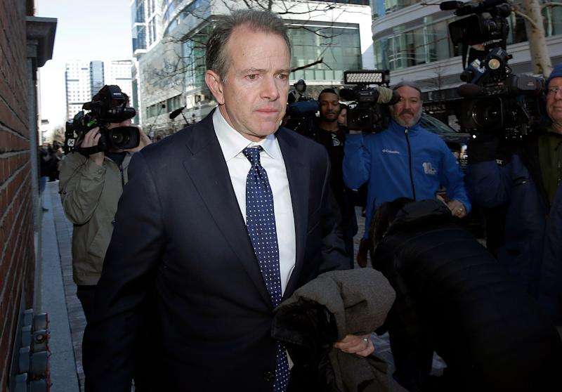 Gordon Ernst, former Georgetown tennis coach, departs federal court in Boston on Monday, March 25, 2019, after facing charges in a nationwide college admissions bribery scandal. (AP Photo/Steven Senne) ORG XMIT: BX115