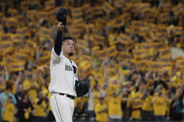 "With the ""King's Court"" cheering section behind him, Seattle Mariners starting pitcher Felix Hernandez tips his cap as he takes the mound for the team's baseball game against the Oakland Athletics, Thursday, Sept. 26, 2019, in Seattle. The game is Hernandez's final start of the 2019 season. (AP Photo/Ted S. Warren)"