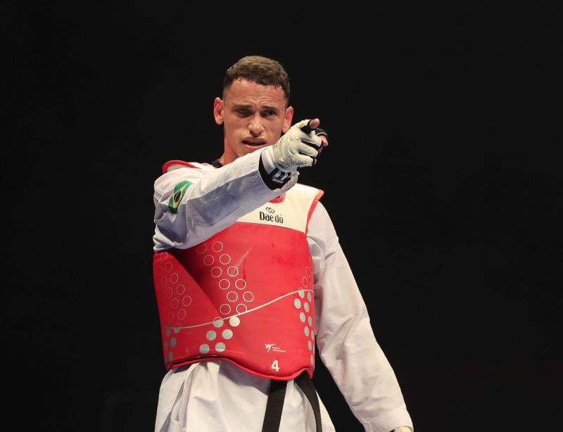 19th May 2019; Manchester Arena, Manchester, England; Taekwondo World Championships; Icaro Miguel Martins Soares (BRA) points to his coach after his -87kg semi-final victory over Ivan Sapina (CRO) (Photo by Conor Molloy/Action Plus via Getty Images)