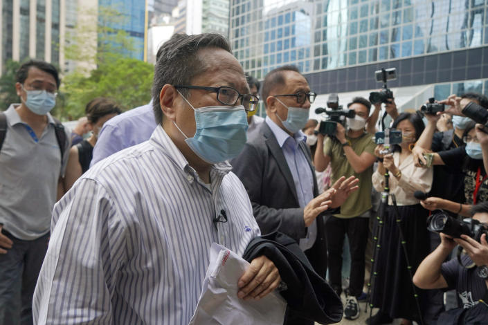 """Various defendants including pro-democracy activists, Albert Ho, center, and Yeung Sum, right, arrive at a court in Hong Kong, Monday, May 17, 2021. Trial starts for Jimmy Lai and nine others, accused of """"incitement to knowingly take part in an unauthorized assembly"""" for a protest march on Oct. 1, 2019. The court has estimated 10 days for this trial. (AP Photo/Kin Cheung)"""