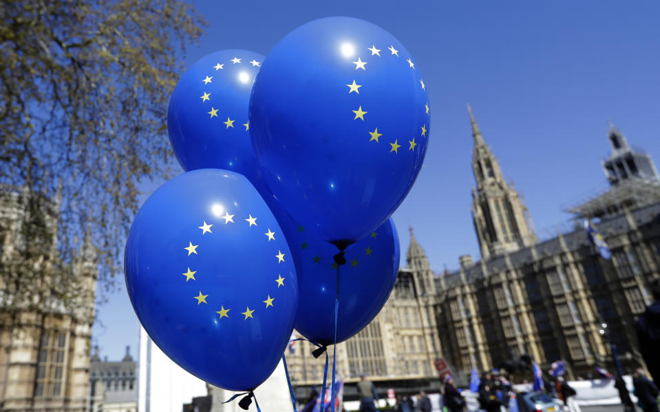 Balloons bearing the star emblem of the European Union flag fly near Parliament in London, Wednesday, April 10, 2019.   Just days away from a no-deal Brexit, European Union leaders meet Wednesday to discuss granting the United Kingdom a new delay to its departure from the bloc.(AP Photo/Kirsty Wigglesworth)