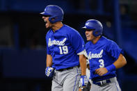 Israel's Danny Valencia, left, celebrate with Ian Kinsler after hitting a two run home run during the eight inning of a baseball game against the Dominican Republicat at the 2020 Summer Olympics, Tuesday, Aug. 3, 2021, in Yokohama, Japan. (AP Photo/Matt Slocum)