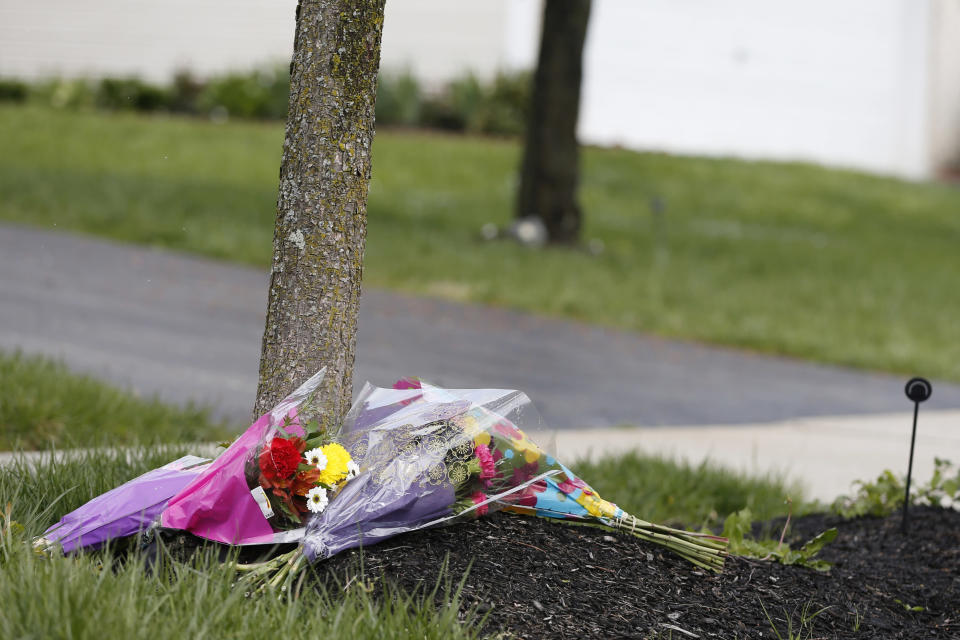 Flowers lay in a makeshift memorial in the neighborhood where a Columbus police officer fatally shot a teenage girl Wednesday, April 21, 2021, in Columbus, Ohio. (AP Photo/Jay LaPrete)