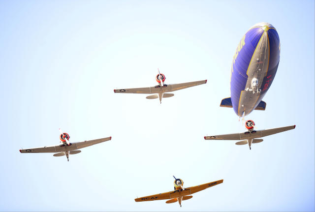 Aircraft fly over the stadium before Game 4 of the National League baseball championship series between the St. Louis Cardinals and the Los Angeles Dodgers, Tuesday, Oct. 15, 2013, in Los Angeles. (AP Photo/Mark J. Terrill)