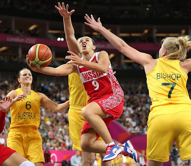 LONDON, ENGLAND - AUGUST 11: Becky Hammon #9 of Russia drives for a shot attempt against Abby Bishop #7 of Australia during the Women's Basketball Bronze Medal game on Day 15 of the London 2012 Olympic Games at North Greenwich Arena on August 11, 2012 in London, England. (Photo by Christian Petersen/Getty Images)