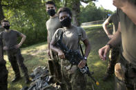 Niara Pelton, of Houston, Texas, carries her M-4 Carbine during drills, Friday, Aug. 7, 2020, in West Point, N.Y. The pandemic is not stopping summer training at West Point. Cadets had to wear masks this year for much of the training in a wooded area just beyond the main gates of the U.S. Military Academy. (AP Photo/Mark Lennihan)