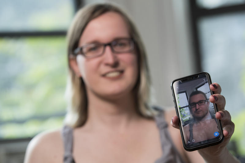 In this Wednesday, May 15, 2019, photo, Bailey Coffman shows her photo as a man in the Snapchat app during an interview in New York. Snapchat's new photo filter that allows users to change into a man or woman with the tap of a finger isn't necessarily fun and games for transgender people. But some others see the potential for such tools to lead to self-discovery among people struggling with their gender identity. (AP Photo/Mary Altaffer)