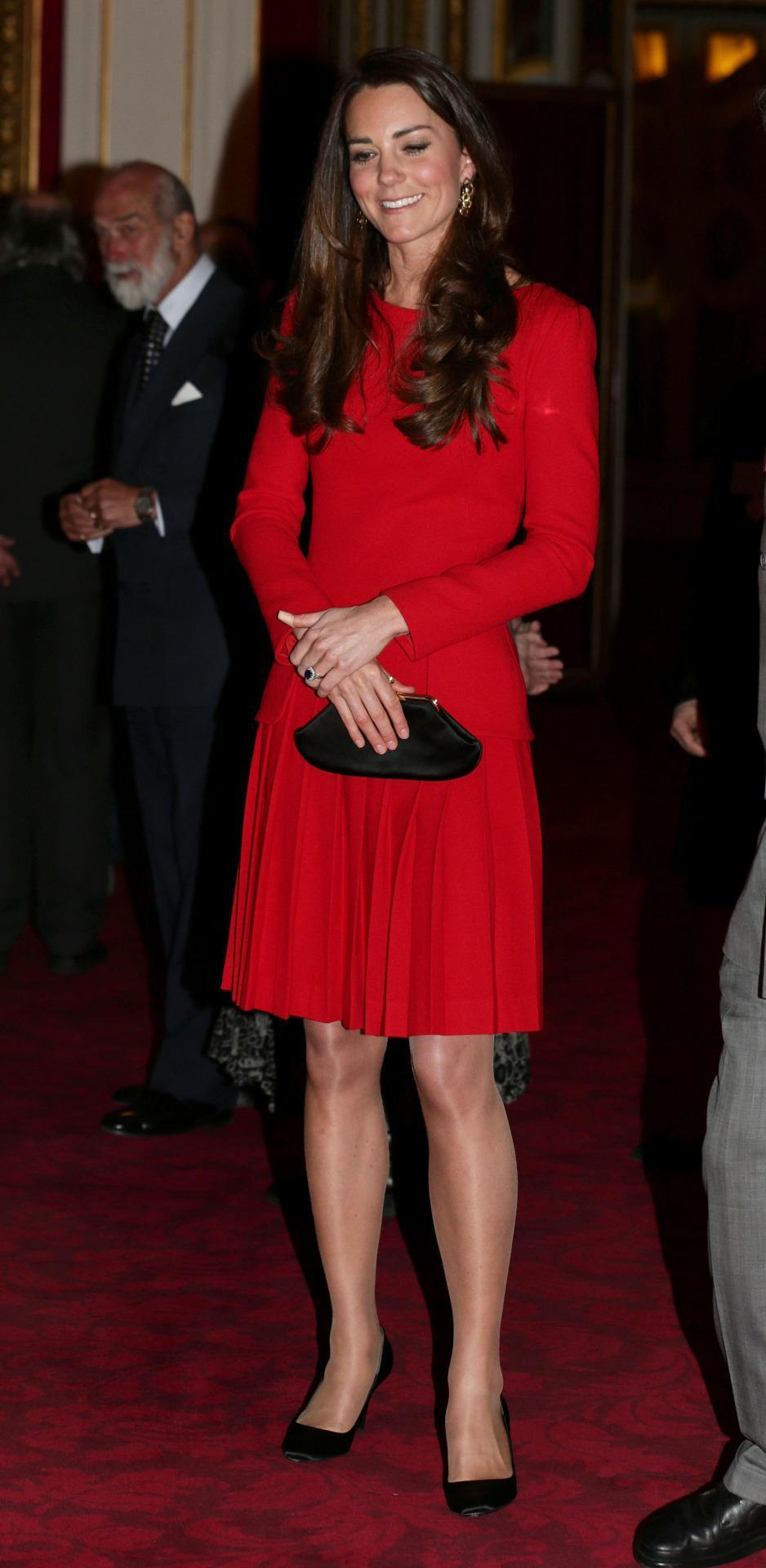 <p>During an arts reception at Buckingham Palace, Kate wore a vivd red Alexander McQueen dress with a bespoke Anya Hindmarsh clutch and black Prada pumps.</p><p><i>[Photo: PA]</i></p>