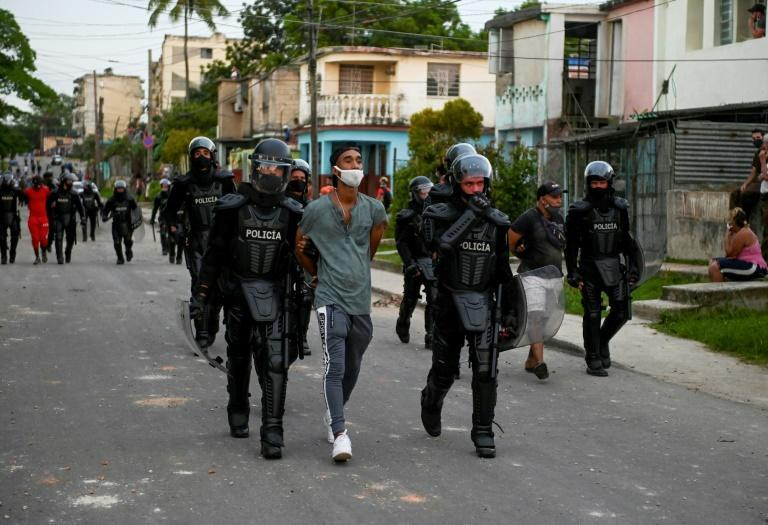A man is arrested during a demonstration against the Cuban government of President Miguel Diaz-Canel in Arroyo Naranjo Municipality, Havana