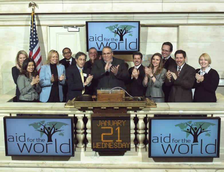 In this Jan. 21, 2009 photo provided by the New York Stock Exchange, the Rev. Carl Keyes, founder of Aid for the World, rings the opening bell at the New York Stock Exchange. Keyes ran Aid for the World, which boasted of operating anti-poverty programs in the U.S. and on several continents, for more than three years without disclosing its finances as required. (AP Photo/NYSE)