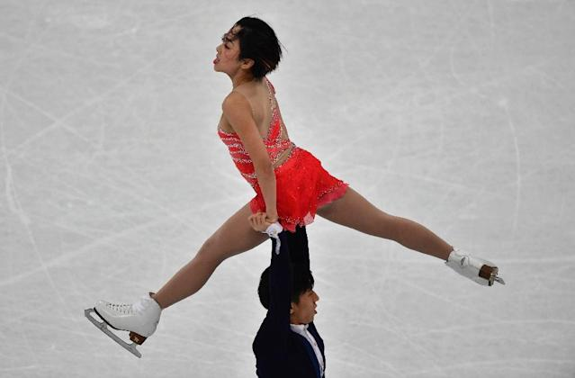 Gold medallists China's Sui Wenjing and Han Cong compete in the pairs free skating event at the ISU World Figure Skating Championships in Helsinki, Finland on March 30, 2017 (AFP Photo/John MACDOUGALL)