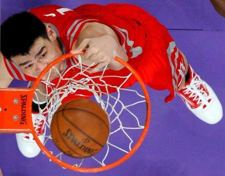 Houston Rockets Yao Ming of China slam dunks against the Los Angeles Lakers during the second half of their NBA game in Los Angeles, California, October 26, 2010. REUTERS/Lucy Nicholson