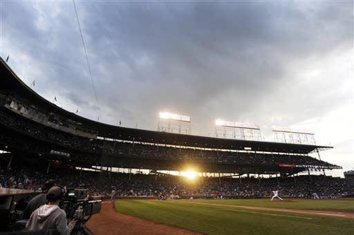 Chicago Cubs starter Jeff Samardzija delivers a pitch during the first inning of a baseball game against the Colorado Rockies at Wrigley Field in Chicago, Wednesday, May 15, 2013. (AP Photo/Paul Beaty)