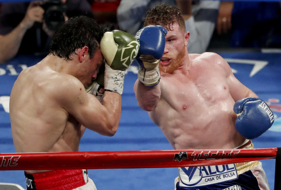 Mexican boxers Canelo Alvarez and Julio Cesar Chavez Jr. compete in their catch-weight boxing match in Las Vegas. (AP Photo/Isaac Brekken)