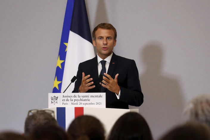 French President Emmanuel Macron delivers the closing speech at the national convention on mental health and psychiatry at the Ministry of Solidarity and Health in Paris, Tuesday, Sept. 28, 2021. Psychology appointments in France will be funded by the government starting next year, the president announced Tuesday, amid growing awareness of the importance of mental health. (Gonzalo Fuentes/Pool Photo via AP)
