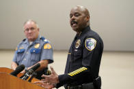 Redmond Police Chief Darrell Lowe, right, speaks at a news conference, Wednesday, July 14, 2021, in Redmond, Wash., about the earlier arrest of former Seattle Seahawks and San Francisco 49ers NFL football star Richard Sherman as Washington State Patrol Capt. Ron Mead looks on. Sherman was arrested after authorities said he tried to force his way into a family member's home in suburban Seattle and fought with officers. Online records say Sherman was booked into a jail early Wednesday on suspicion of so-called burglary domestic violence. (AP Photo/Elaine Thompson)