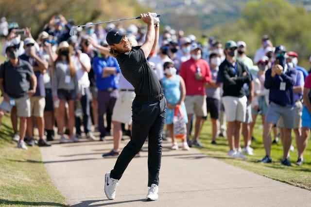 Tommy Fleetwood hits a shot off the cart path
