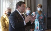 FILE - In this Sept. 25, 2020, file photo, Florida Gov. Ron DeSantis announces the state's phase three openings at a news conference in St. Petersburg, Fla. As the summer coronavirus spike in Sunbelt states subsides, Florida has gone the furthest in lifting restrictions, especially on restaurants where the burden of ensuring safety has shifted to business owners and residents _ raising concerns of a resurgence. (John Pendygraft/Tampa Bay Times via AP, File)