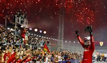 Sebastian Vettel gestures to the crowd after his win. (PHOTO: Singapore GP)