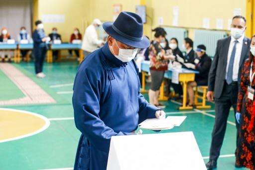 The Mongolian People's Party of Prime Minister Khurelsukh Ukhnaa, seen here voting in Ulaanbaatar, was handed an overwhelming parliamentary majority by voters