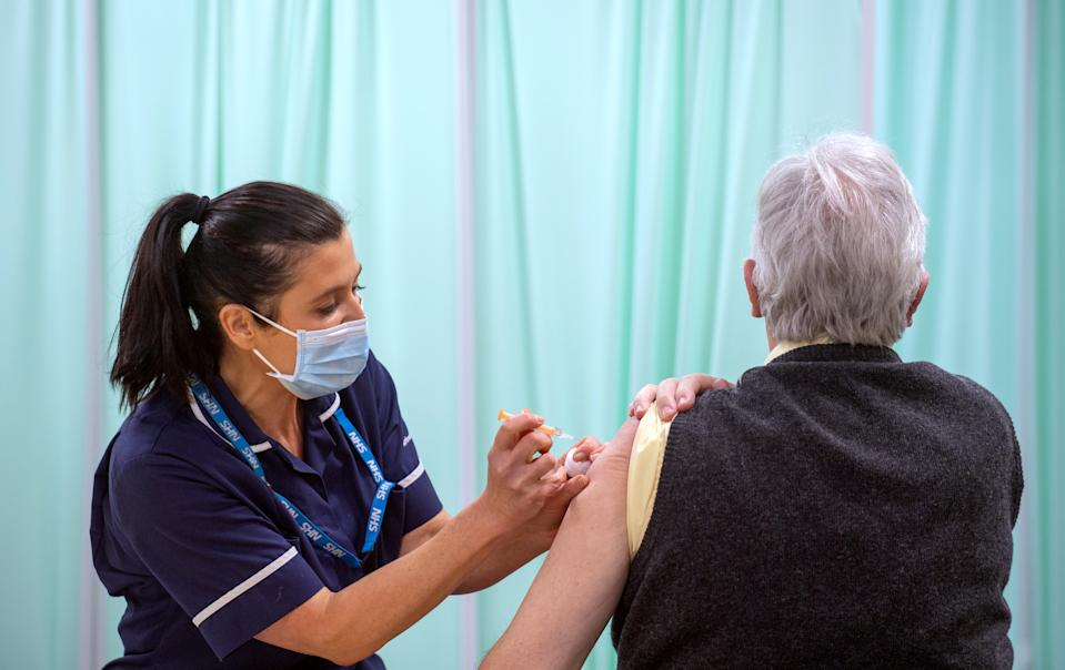 A patient receives an injection of a Covid-19 vaccine at the NHS vaccine centre that has been set up at Robertson House in Stevenage, Hertfordshire. The centre is one of the seven mass vaccination centres now opened to the general public as the government continues to ramp up the vaccination programme against Covid-19.