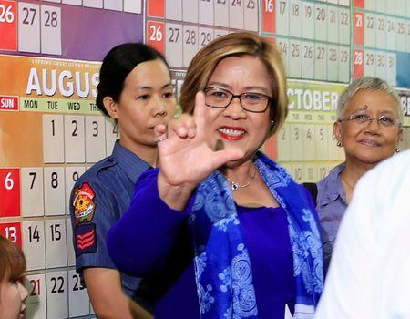 "FILE PHOTO: Philippine Senator Leila de Lima, who is detained on drug charges, gestures a ""Laban"" (Fight) sign inside a local court where she faces an obstruction of justice complaint in Quezon city, metro Manila, Philippines March 13, 2017. REUTERS/Romeo Ranoco"