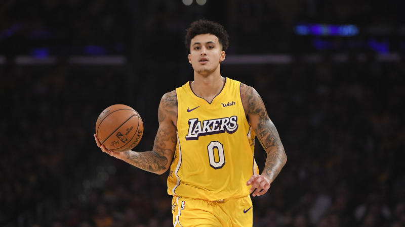Los Angeles Lakers forward Kyle Kuzma dribbles during the first half of an NBA basketball game against the Washington Wizards Friday, Nov. 29, 2019, in Los Angeles. (AP Photo/Mark J. Terrill)