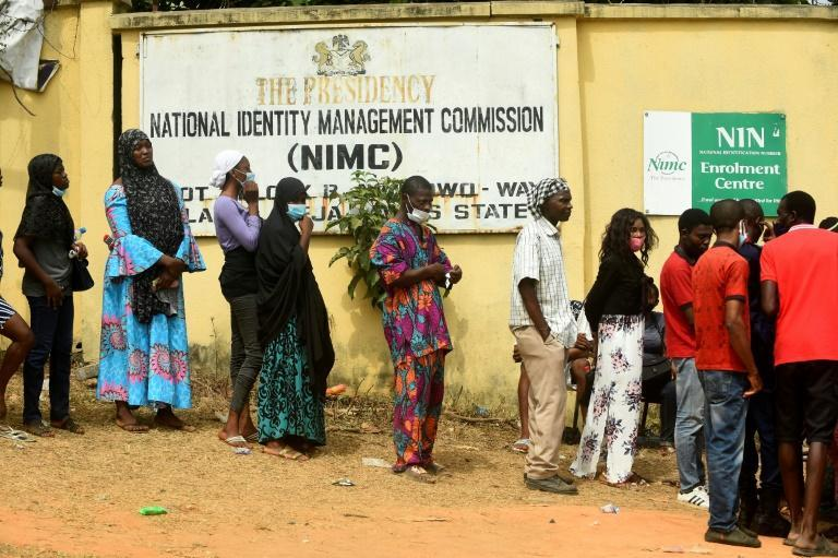Nigerians queue to obtain the precious National Identity Number -- without it, their mobile phone may be cut off