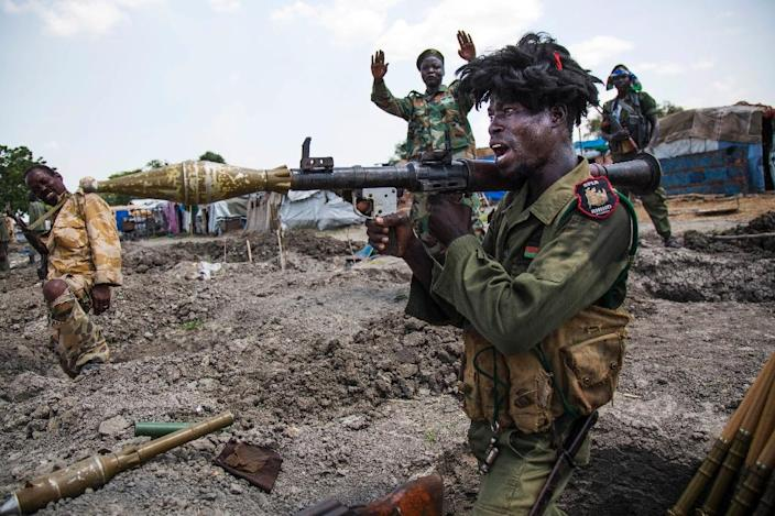 Under the proposed resolution, South Sudan's rebel leader Riek Machar, army chief Paul Malong and Information Minister Michael Makuei would be put on a sanctions blacklist, subjected to an assets freeze and a global travel ban (AFP Photo/Albert Gonzalez Farran)