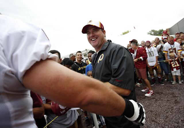 Washington Redskins head coach Jay Gruden smiles while greeting fans after practice at the team's NFL football training facility, Sunday, July 27, 2014, in Roanoke, Va. (AP Photo/Alex Brandon)