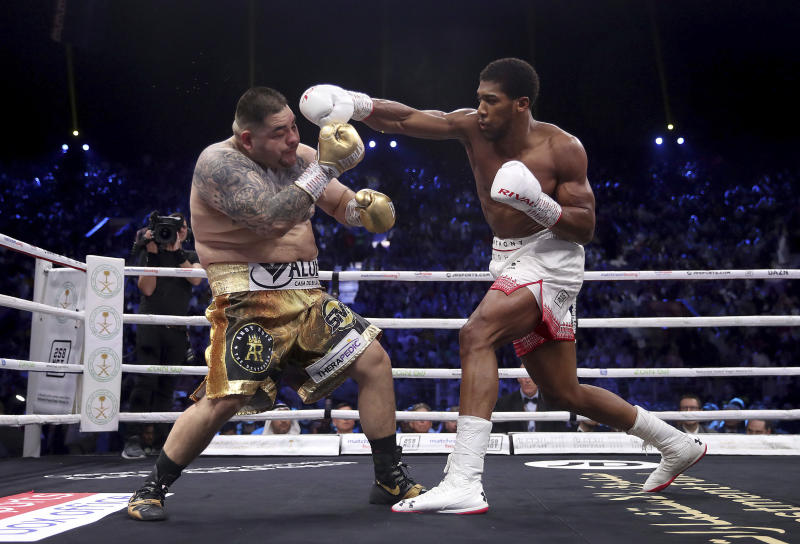 Defending champion Andy Ruiz Jr., left, during his fight against Britain's Anthony Joshua in their World Heavyweight Championship contest at the Diriyah Arena, Riyadh, Saudi Arabia. (Nick Potts/PA via AP)