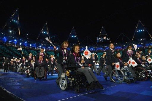 Members of Japan's delegation parade during the opening ceremony of the London 2012 Paralympic Games at the Olympic Stadium in east London. The Paralympic cauldron was lit in London on Wednesday to burn for 11 days of sport at the biggest and most high-profile Games that organisers hope will transform ideas about disability the world over