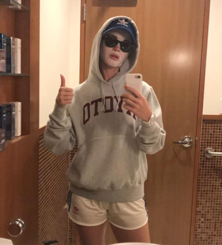 <p>The singer gave a thumbs up in a mirror selfie on her Instagram stories as she donned a sheet mask while wearing sunglasses and a baseball cap. </p>