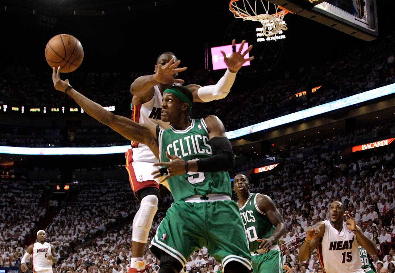 MIAMI, FL - JUNE 09:  Rajon Rondo #9 of the Boston Celtics goes up for a shot over his head against Dwyane Wade #3 of the Miami Heat in the second quarter in Game Seven of the Eastern Conference Finals in the 2012 NBA Playoffs on June 9, 2012 at American Airlines Arena in Miami, Florida. NOTE TO USER: User expressly acknowledges and agrees that, by downloading and or using this photograph, User is consenting to the terms and conditions of the Getty Images License Agreement.  (Photo by Mike Ehrmann/Getty Images)