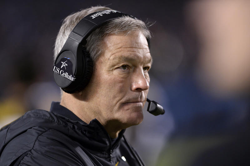"""FILE - In this Dec. 27, 2019, file photo, Iowa coach Kirk Ferentz watches from the sideline during the second half of the team's Holiday Bowl NCAA college football game against Southern California  in San Diego. Iowa football strength and conditioning coach Chris Doyle has been placed on administrative leave after several black former players posted on social media about what they described as systemic racism in the program. Ferentz made the announcement Saturday, June 6, 2020, calling it """"a defining moment"""" for Iowa's football program in a video posted on the team's Twitter account. (AP Photo/Orlando Ramirez, File)"""