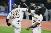 Pittsburgh Pirates' Gregory Polanco (25) celebrates with Josh Bell (55) after hitting a two-run home run off Cleveland Indians starting pitcher Carlos Carrasco during the fourth inning of a baseball game Friday, Sept. 25, 2020, in Cleveland. (AP Photo/Ron Schwane)