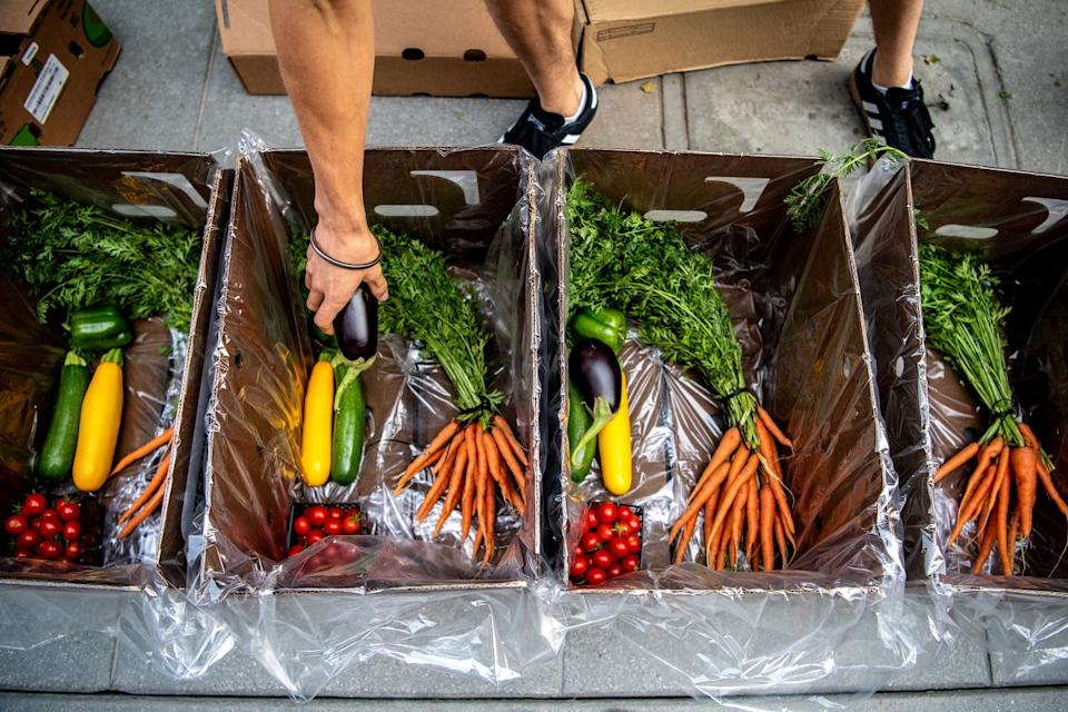 Produce packages are prepared at the Santa Monica Farmers Market.